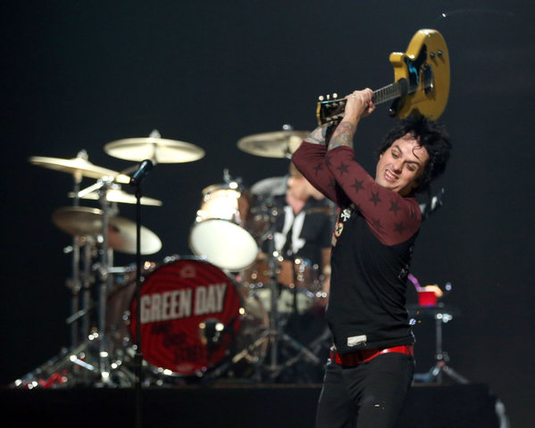 Billie Joe Armstrong smashes his guitar up
